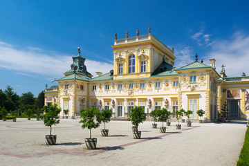 The royal Wilanow Palace in Warsaw, Poland, with gardens, statues and river around it