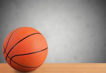 Orange Basketball ball on gray background