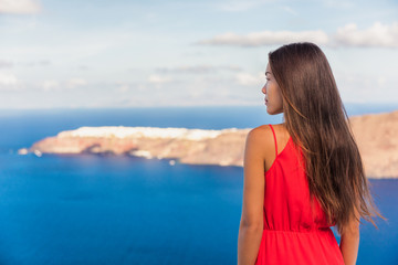 Fototapete - Santorini greece travel luxury destination Asian woman beauty at Oia landscape background. Tourist girl on holiday.