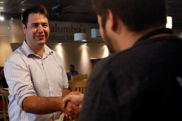 Democratic candidate Danny O'Connor, in Ohio's 12th congressional district, shakes hands with a coffee shop employee ahead of Tuesday's special election in Newark, Ohio