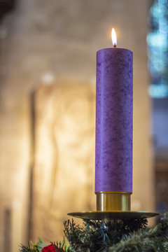 One candle flaming during Christmas at Bristol Cathedral, a Christianity religion representation