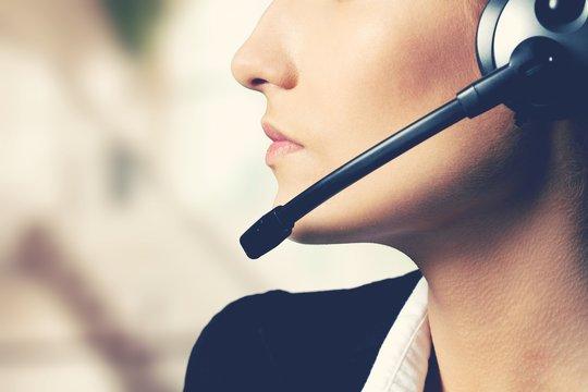 Woman Call Center operator on dark background