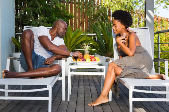 Romantic African Couple Relaxing and Enjoying Wine and Fruit Outdoors