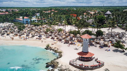 Beautiful Beach at a resort in the Caribbean. View of the beach and the lighthouse. Aerial view
