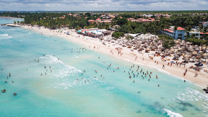 a lot of people on the beach at a resort in the Caribbean. Aerial view