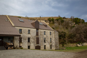 An old empty stone flour mill in the countryside