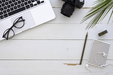 Flat lay summer freelancer workspace. Computer, and photo camera top view summer business background mockup