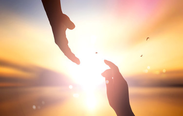 The concept of God's salvation:silhouette of helping hand concept and international day of peace