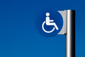 Handicapped sign on a steel post