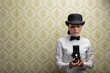 Elegant vintage woman photographer