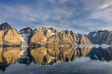 Beautiful Greenland fjord  landscape with reflection in water