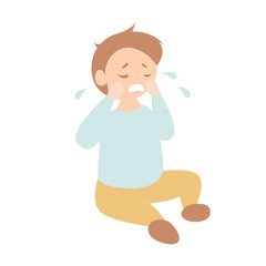 Cute toddler boy crying on the floor