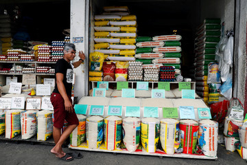 A vendor waits for customers at a rice and egg shop in Paranaque, Metro Manila