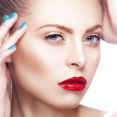 Beautiful Fashion Model Girl Face. Professional Makeup. Perfect manicure. Red Lipstick. White background