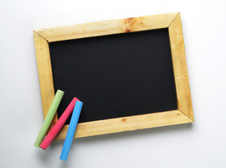 Blank Wooden Frame Blackboard with Colorful Chalk