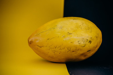 Yellow canary melon on the yellow background