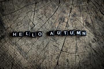 Hello autumn. Wooden background