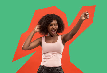 I won. Winning success happy woman celebrating being a winner. Dynamic image of caucasian female model on red studio background. Victory, delight concept. Human facial emotions concept. Trendy colors