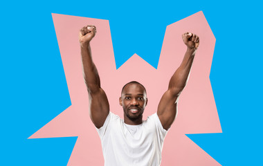 I won. Winning success happy man celebrating being a winner. Dynamic image of afro male model on green studio background. Victory, delight concept. Human facial emotions concept. Trendy colors