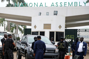 Members of security forces block the entrance of the National Assembly in Abuja