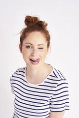 Portrait of girl licking her lips at studio shot