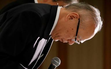 Tetsuo Yukioka, Managing Director of Tokyo Medical University, bows during a news conference in Tokyo