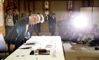 Tetsuo Yukioka, Managing Director of Tokyo Medical University and Keisuke Miyazawa, Vice-President of Tokyo Medical University, bow as they attend a news conference in Tokyo