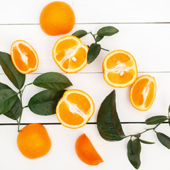 Halves of fresh orange on a white wooden table