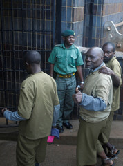 Movement For Democratic Change (MDC) supporters arrested last week for violent protests arrive for bail application at the Harare Magistrates courts in Harare