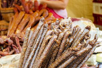 smoked sausages in street market