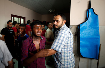 Relative of a Palestinian Hamas militant who was killed in Israeli tank shelling, reacts at a hospital in the northern Gaza Strip