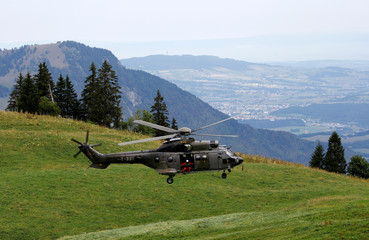 A Swiss Air Force Super Puma helicopter arrives near Rossiniere
