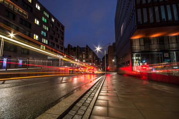HAMBURG, GERMANY - JULY 09, 2018: Streets and buildings in Hamburg at night. The second largest city in Germany. Long exposure shot.