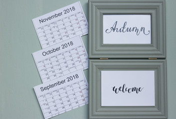 Image of all three autumn months in pleasant minty color. You can see full calendars of September, October and November 2018 with lunar days and holidays. Concept: Autumn welcome!