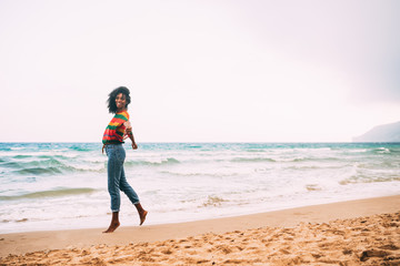woman walking on the beach barefoot