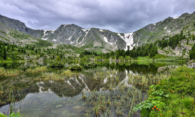 One from seven cleanest mountain Karakol lakes, located in the valley at the foot of Bagatash, Altai mountains, Russia