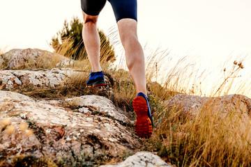 legs men runner athlete running uphill in mountain