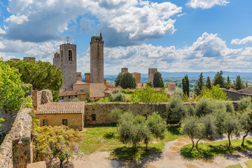 Cityscape of San Gimignano with the Courtyard of the ancient fortress ruin in Italy