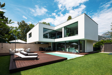 Exterior modern white villa with pool and garden
