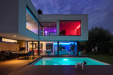 Modern villa with colored led lights at night Wall mural