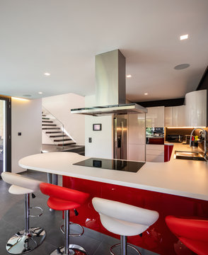 Red kitchen detail in modern villa