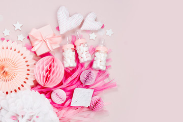 Pink and white Paper Decorations for Baby shower party. It's a Girl. Flat lay, top view