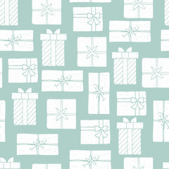 Seamless creative pattern with cartoon gift boxes. Soft colored vector print. Christmas creative wrapping.