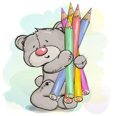 Teddy bear holding a large pencil