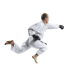 A man in black gloves beats with a hand in a jump isolated