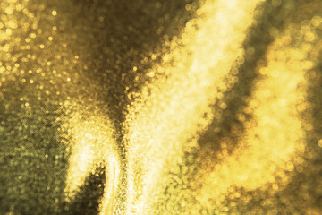 Gold wavy. Luxury cloth or liquid wave or wavy folds of grunge silk texture . Abstract concept. Wall mural