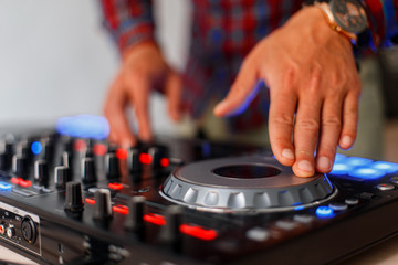 Hands  with audio control. Mixing tracks. Professional Controller