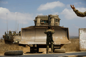 Israeli soldiers take part in an army drill during a visit of Israeli Defence Minister Avigdor Lieberman in the Israeli-occupied Golan Heights