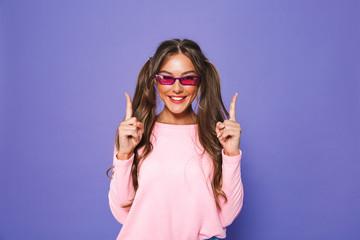 Portrait of a satisfied girl in sweatshirt in sunglasses