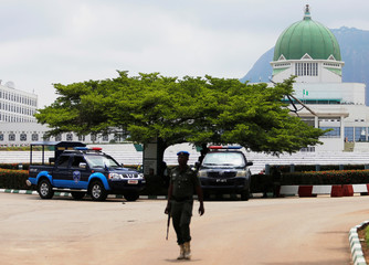 A policeman walks outside the National Assembly in Abuja